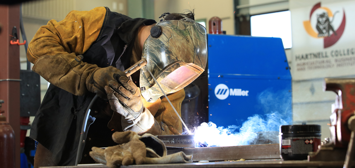 Hartnell College Instructor teaching Welding