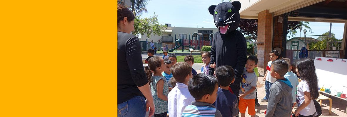 Oscar the Hartnell College Mascot visits the Hartnell College Child Development Center