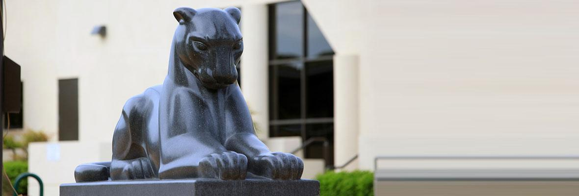 Oscar the Hartnell College mascot carved into 25,000 lbs of granite